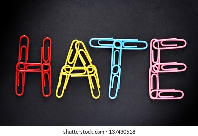 Office hate concept, spelled with paperclips
