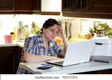 Office in the home kitchen, businesswoman. Work at home.