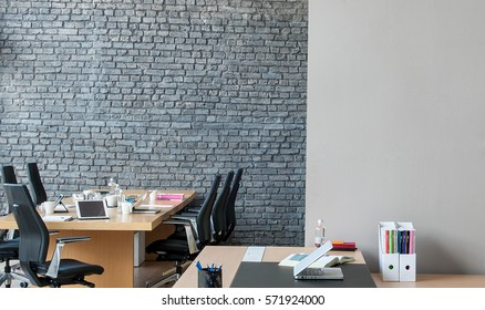 office interior behind brick wall
