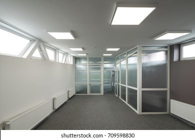 Office interior with glass walls.