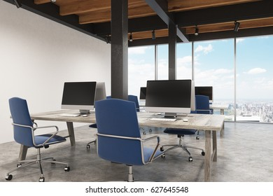 Office interior with metal pillars, two computers standing on the desk and a panoramic cityscape. 3d rendering, mock up