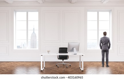 Office interior with workspace, businessman and NYC view. 3D Rendering