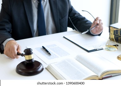 In the office of Judge or lawyer, there are balance and gavel on the table. Law firm Concept.