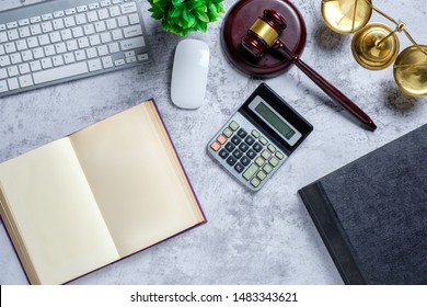 Office lawyer desk with law books,calculator,computer, Judge gavel and scales of justice. Justice and law concept. Top view