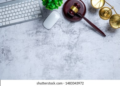 Office lawyer desk with law books,laptop computer, Judge gavel and scales of justice.justice and law concept.