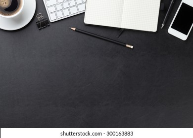 Office leather desk table with computer, supplies and coffee cup. Top view with copy space - Shutterstock ID 300163883