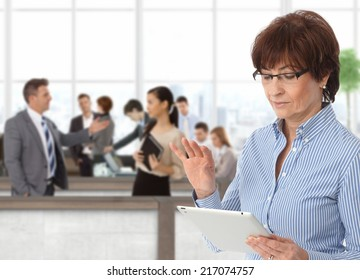 Office life senior businesswoman with tablet