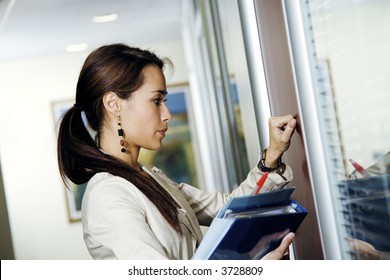 Office life: young secretary knocking on her boss? door