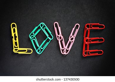 Office love concept, spelled with paperclips