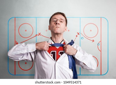 The office man opens a white shirt and shows the hockey sports form. Against the backdrop of the coaching scheme of halftime. Hero