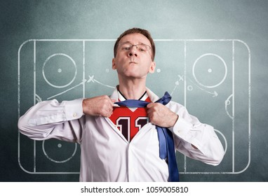 The office man opens a white shirt and shows the hockey sports form. On the background drawing coaching scheme of the game. Hero