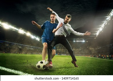 Office man as a soccer or football player at the stadium. Kicking a ball for a goal while playing for the favourite team he bet on. Concept of business, finance, betting, win, action and movement.