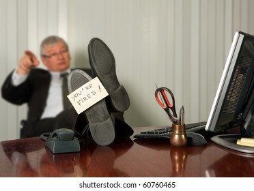 Office manager firing an employee with a yellow sticky note on his shoe