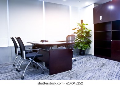The office of the manager of the modern company. The sun shines on the tables and chairs