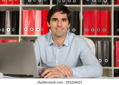 Office manager working on laptop