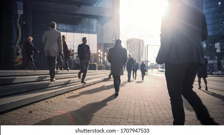 Office Managers and Business People Commute to Work in the Morning or from Office on a Sunny Day on Foot. Pedestrians are Dressed Smartly. Successful People Walking in Downtown. Cloudy Day in Downtown