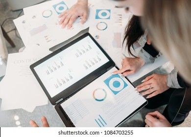 office meeting. business team brainstorming. group of workers study documents with graphs and diagrams. information analysis