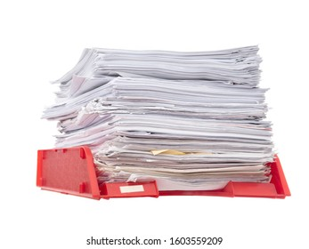 Office paper filing tray isolated on white background. Lots of paperwork, work, bureaucracy. Administration concept.