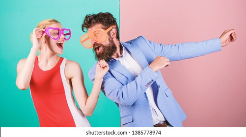 Office party. Best friends. Couple in love. Relations. Happy couple in party glasses. Summer vacation and fashion. Frienship of happy man and woman. Hipster. Just having fun. Simply being around.