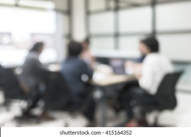 Office people meeting in blur background working in team discussion or small seminar group
