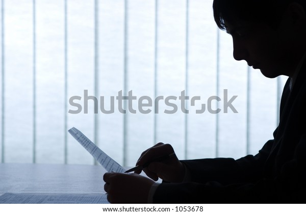 Office picture, man with pen and contract. Nice backlight and feeling, image is very clean, as always.