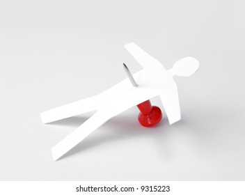 Office politics. Paper doll stabbed with red push pin. Abstract concept of fallen businessman.