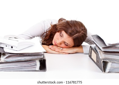 Office portrait of beautiful young business woman sleeping at her workplace