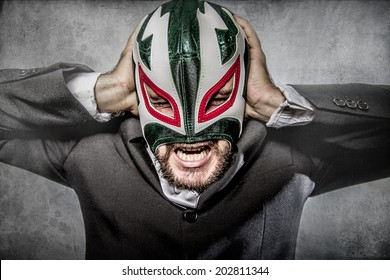 Office problems, aggressive executive suit and tie, Mexican wrestler mask