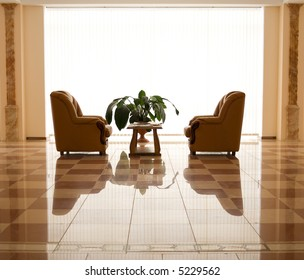 Office room with chairs and table. Floor reflection