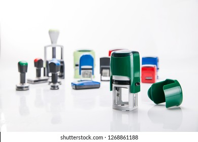 Office rubber stamp. Mechanism of a rubber stamp on a white background.