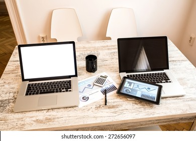 Office setup with a laptop computer and a Tablet PC.