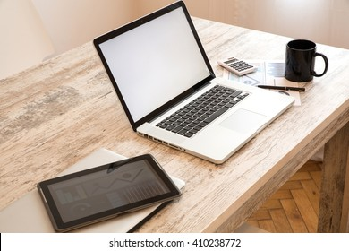 A office setup with a Laptop computer and a Tablet PC.
