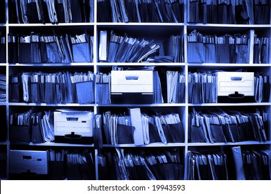 Office shelves full of files and boxes
