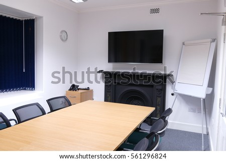 Blue White Office Space Teal Office Space With Tv Screen Wooden Table Tv Old Architecture Type Fireplace Shutterstock Office Space Tv Screen Wooden Table Stock Photo edit Now 561296824