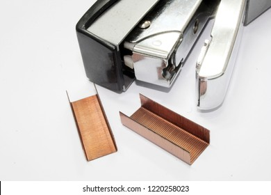 Office stapler filled with staples isolated on white background