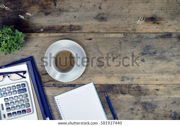 Office stuff and it gadgets display on top view business desk with copy space at text of picture. Creative table, modern project. Business empty vintage is background. Dark tone.Flat lay.