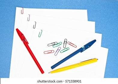 office supplies - colored paper clips and pens