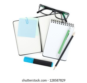 Office supplies and glasses. View from above. Isolated on white background