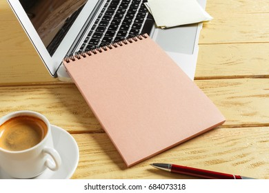 Office table background with coffee cup, pencils and computer keyboard. Business workplace or workspace concept.