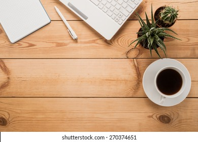 Office table with cup of coffee