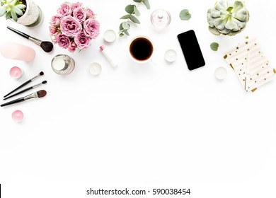 Office table desk. Flat composition, magazines, social media. Top view. Flat lay. Home office workspace. Women's fashion. bouquet of roses, eucalyptus, coffee on white background.
