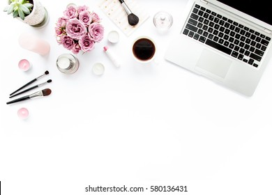 Office table desk. laptop, computer. magazines, social media. Top view. Flat lay. Home office workspace. Women's fashion. bouquet of roses, notebook, coffee on white background. makeup tools brushes