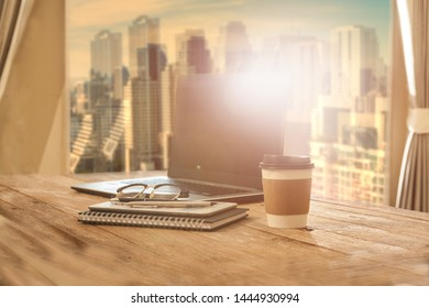 Office table with notebook and cup of coffee
