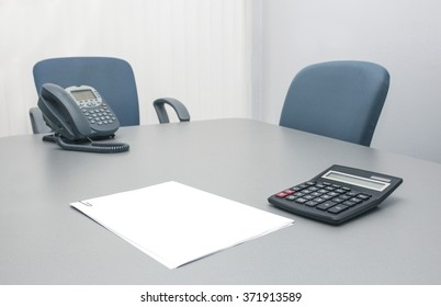 office table paper phone calculator