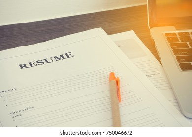 Office table with Resume Document form and laptop. concept of find job.