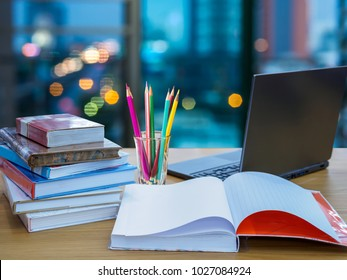 Office table with stack of books, laptop computer / Business background & Education  concept