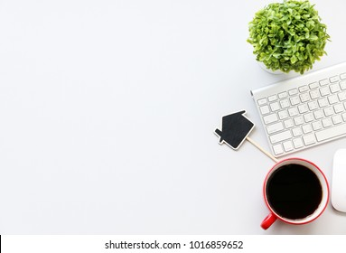 Office table with tablet,keyboard,pen,coffee cup and cactus, copy space,Top view, flat lay