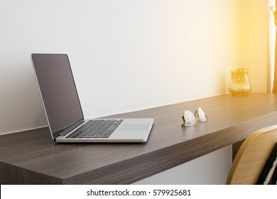 office table white laptop, modern chair and modern eyeglasses. concept of business lifestyle. view from side office table.