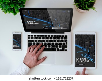 office tabletop with tablet, smartphone and laptop showing digital business responsive design website