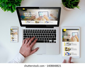 office tabletop with tablet, smartphone and laptop showing responsive ux design website
